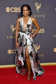 Regina King sealed off her red carpet look with a pair of silver triple-strap heels.