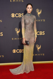 Amanda Crew polished off her look with a gray satin envelope clutch by Tyler Ellis.
