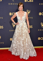 Allison Janney donned a nude Tony Ward gown with an illusion neckline and white floral embroidery for the 2017 Emmys.