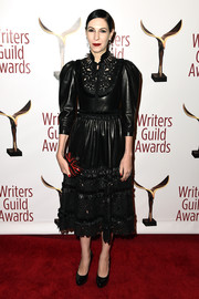 Jill Kargman gave us '80s vibes with this black Gucci leather dress with puffed sleeves and laser-cut detailing at the Writers Guild Awards.