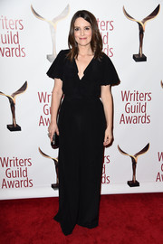 Tina Fey donned a black flutter-sleeve jumpsuit by Michael Kors for a relaxed yet sophisticated vibe at the Writers Guild Awards.