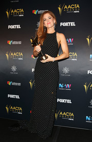 Isla Fisher looked darling in a crystal-dot black gown by Alex Perry at the AACTA Awards.