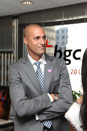 Nigel Barker looked fierce in a silver chronograph watch, the perfect accent to a classic gray suit.