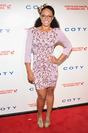 Elle Varner won for the most playful look fo the night in this purple leopard number at the DKMS Gala.