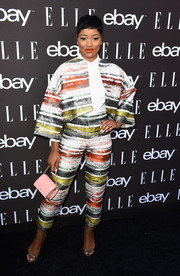 Keke Palmer looked exuberant at the Elle Women in Music celebration in a Rubin Singer pantsuit rendered in multicolored stripes.