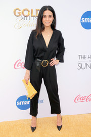 Emmanuelle Chriqui was casual-chic in a black kimono jumpsuit by Dame at the Gold Meets Golden party.