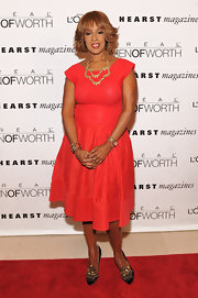 Gayle King wore a vibrant frock with cap sleeves and statement necklace to the Women of Worth Awards.