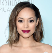 Amber Stevens West gave her beauty look a vibrant pop of color with a swipe of berry lipstick.