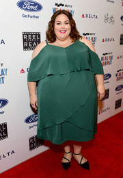 Chrissy Metz attended the Reel Stories, Real Lives event wearing a trendy green cold-shoulder dress.