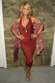 Christie looks absolutely stunning in this curve hugging copper dress and her blonde curls give her a youthful glow.