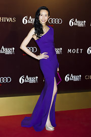 Karen Mok wore this vibrant purple gown with an over-the-knee slit to the Asian Film Awards in Hong Kong.