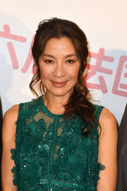 Michelle Yeoh wore her hair in a glamorous side sweep during the 6th Chinese Film Festival photocall.