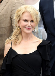 Nicole Kidman looked oh-so-sweet with her loose side braid at the Cannes Film Festival 70th anniversary photocall.