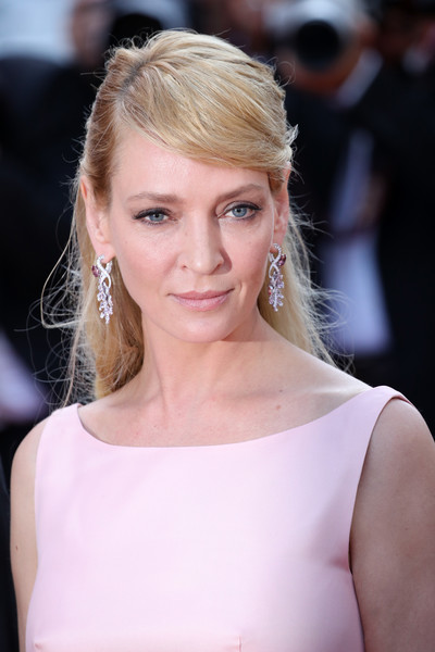 Uma Thurman went for a casual half-up style with side-swept bangs when she attended the Cannes Film Festival 70th anniversary event.
