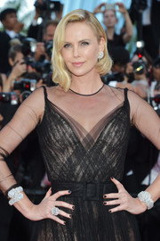 Charlize Theron stunned us with those massive Chopard diamond bracelets at the Cannes Film Festival 70th anniversary event.