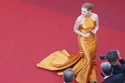 Jessica Chastain looked superb in a structured marigold halter gown by Armani Privé at the Cannes Film Festival 70th anniversary event.