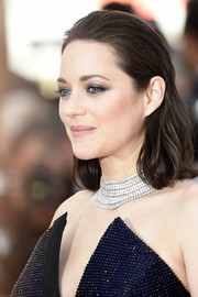 Marion Cotillard kept it simple with this subtly wavy, brushed-back 'do at the Cannes Film Festival 70th anniversary event.