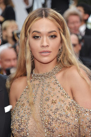Rita Ora sported a hippie-glam hairstyle at the Cannes Film Festival 70th anniversary event.