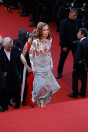 Isabelle Huppert donned a gray and white Louis Vuitton gown with a beaded bodice and sleeves for the Cannes Film Festival 70th anniversary event.