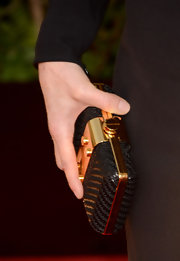 Eva Longoria chose a woven leather clutch with gold hardware for her Golden Globes appearance.