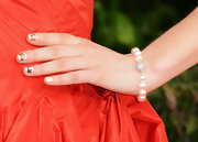 A pearl bracelet provided a ladylike finish to Deschanel's Golden Globes look.