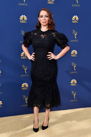 Maya Rudolph kept it classic in a black Simone Rocha lace dress with puffed sleeves and a fluted hem at the 2018 Emmys.