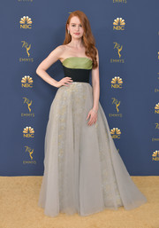 Madelaine Petsch chose a strapless tricolor gown with a sparkly underlay for the 2018 Emmy Awards.