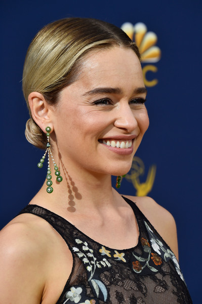 Emilia Clarke styled her hair into a center-parted chignon for the 2018 Emmys.