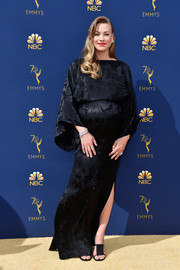 Yvonne Strahovski attended the 2018 Emmys wearing a black maternity gown with bell sleeves.