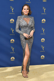 Chrissy Teigen was sparkly and sexy in a silver Zuhair Murad Couture dress with a cleavage-baring cutout and a thigh-high slit at the 2018 Emmys.