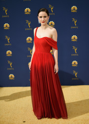 Rachel Brosnahan looked divine in a red off-one-shoulder gown by Oscar de la Renta at the 2018 Emmys.