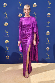 Allison Janney wore diamond and gemstone dangle earrings and a ring by Jared Lehr to the 2018 Emmys.