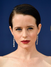 Claire Foy wore her hair in a slick side-parted style at the 2018 Emmys.