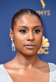 Issa Rae styled her hair into a tight center-parted updo for the 2018 Emmys.