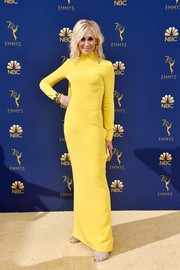 Judith Light cut a svelte silhouette in this high-neck yellow column dress by Christian Siriano  at the 2018 Emmys.