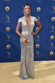 Samira Wiley kept the shine going with a silver clutch by Jimmy Choo.
