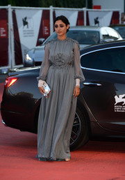 Golshifteh Farahani cut a regal figure in a long-sleeve gray evening dress during the Venice International Film Festival closing ceremony.