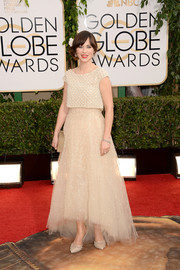 Zooey Deschanel was quirky-glam in a beaded nude Oscar de la Renta gown with a high-low tulle skirt during the Golden Globes.