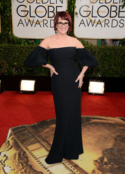 Megan Mullally looked fetching at the Golden Globes in a black off-the-shoulder gown with bell sleeves.