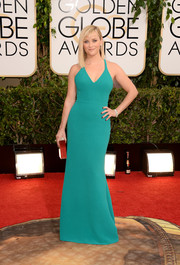 Reese Witherspoon donned a simple yet sophisticated aqua halter gown by Calvin Klein for the Golden Globes.