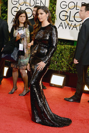 Camila Alves poured herself into a slinky sequined black gown by Dolce & Gabbana for the Golden Globes.