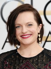 Elisabeth Moss put an edgy spin on her bob when she attended the Golden Globes.