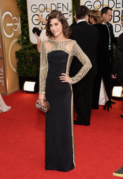 Lizzy Caplan exuded Old Hollywood glamour in an Art Deco-inspired black and gold column dress by Emilio Pucci during the Golden Globes.