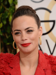 Berenice Bejo pulled her hair back in a high bun for the Golden Globes.
