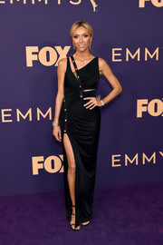 Giuliana Rancic vamped it up in a ruched and slashed column dress by Versace at the 2019 Emmys.
