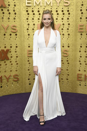 Jodie Comer styled her dress with strappy black heels by Roger Vivier.