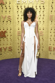 Indya Moore styled her dress with gold ankle-strap sandals, also by Louis Vuitton.