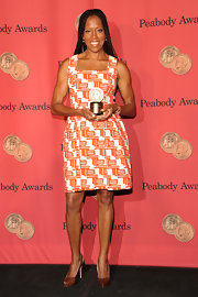 Regina King paired stylish brown snakeskin pumps with her print dress when she attended the George Foster Peabody Awards.