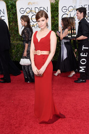 Kate Mara oozed youthful glamour in a sleeveless red Miu Miu gown at the Golden Globes.