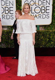 Kristen Wiig went for relaxed sophistication in a boho white off-the-shoulder gown by Delphine Manivet at the Golden Globes.